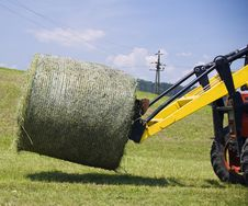 Free Tractor Working With A Hay Bale Royalty Free Stock Photo - 17842275