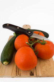 Tomato And Courgette With Knife Stock Images