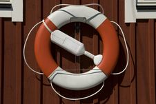 Free Lifebuoy Haning On A House Stock Images - 17844284