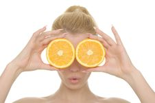 Free Young Woman Holds Halves Of Oranges Before Eyes Royalty Free Stock Photos - 17846928
