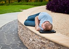 Free Man Sleeping In A Park With Laptop As Pillow Royalty Free Stock Photo - 17846955