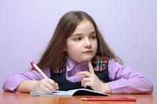 Little School Girl Doing Homeworks At Desk Royalty Free Stock Photos