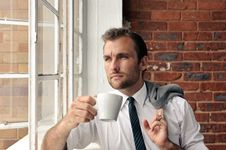 Thoughtful Man With Coffee Stock Photos