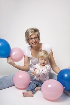 Mother And Daughter Portrait With Balloons Stock Photos