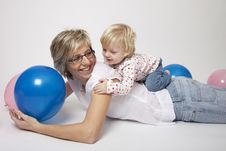 Mother And Daughter Portrait With Balloons Stock Image