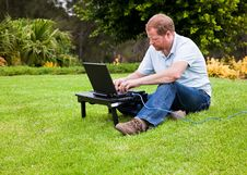 Free Man In Park Using Laptop With Ethernet Cable Royalty Free Stock Photos - 17849878