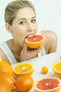 Free Woman Eating Grapefruit Royalty Free Stock Photos - 17851108