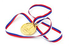 Golden Medal And Ribbon Stock Photography