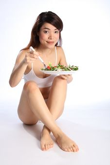 Free Beautiful Young Oriental Girl Eating Salad Stock Photo - 17850940