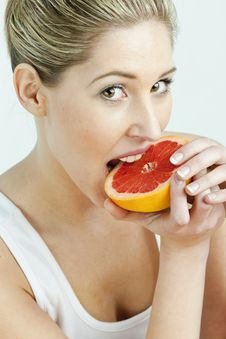 Free Woman Eating Grapefruit Stock Photos - 17851103