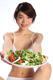 Happy Japanese Girl Holds Plate Of Green Salad Stock Images