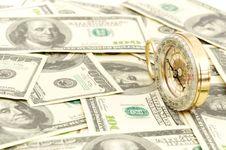 Dollars And Compass. Stock Photos