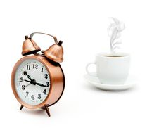 Vintage Alarm Clock And White Coffee Cup Stock Photography