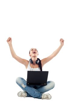 Free Young Woman Sitting With Laptop Raising Hands Stock Photography - 17852762