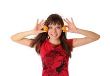 Smiling Girl With Tangerines Stock Image