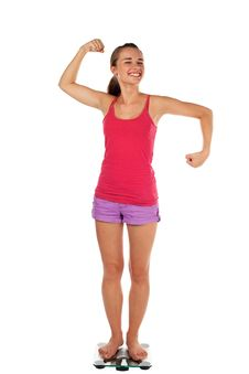 Free Young Woman Tense Muscles On Scale Stock Photos - 17852873