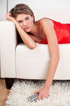 Free Sorrowful Girl Holding A Remote Control Royalty Free Stock Photo - 17857945