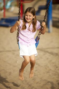 Free Girl Swinging Royalty Free Stock Image - 17862966