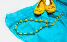Free Yellow Blue Beads On Dress And Shoes Royalty Free Stock Images - 17863649