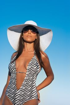 Young Woman In A White Hat And Swimwear Stock Photography