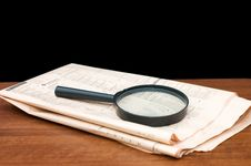 Free Magnify Glass Over A Of Newspaper Stock Image - 17865481
