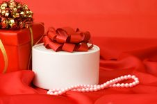 Free Box With A Gift On A Red Fabric Royalty Free Stock Photography - 17865607