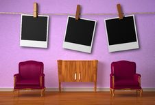 Free Two Chairs With Console And Hanging Frames Royalty Free Stock Photography - 17865917