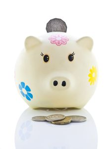 Piggy Bank With Coin Insert Royalty Free Stock Photo