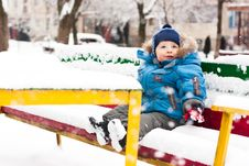 Free Cute Boy Sitting In Snow Outdoor Stock Photo - 17871350
