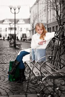Free Woman Sitting On A Bench Stock Photos - 17872283