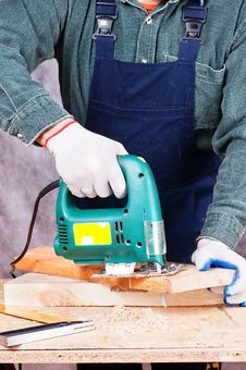 Free Worker With Fret Saw Royalty Free Stock Photography - 17872567