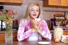 Free Woman Sniffing The Scent Cup Of Hot Drink Royalty Free Stock Photos - 17874058