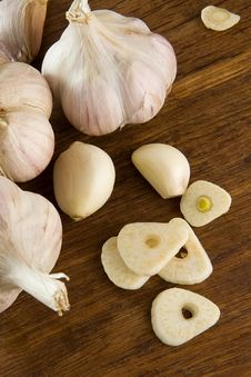 Set Of Garlic On Wooden Texture Stock Photo