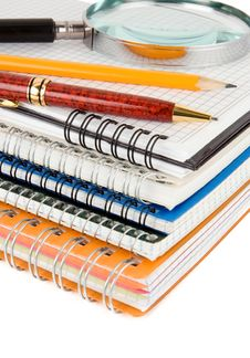 Pen And Pencil On Checked Notebook Royalty Free Stock Image