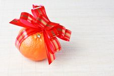 Free Tangerine With Red Goldish Striped Bow As A Gift Stock Photography - 17877422