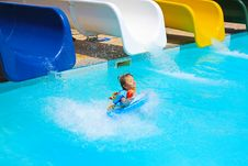 Free Little Girl Falls Into The Pool With Water Slides Stock Photos - 17879233