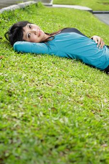 Young Beautiful Girl Smiling And Lying Down