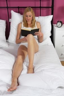 Free Woman Reading Book In Bed Stock Photo - 17879730