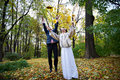 Free Joyful Bride And Groom Throw The Yellow Leaves Stock Photos - 17884213