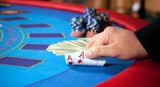Free Hand With Chips, And $ Banknotes On Table Royalty Free Stock Image - 17880186