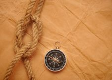Compass And Rope On Old Paper Royalty Free Stock Photos
