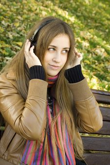 Free Young Woman With Headphones In The Park Royalty Free Stock Image - 17880876
