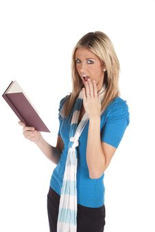Woman Shocked At Book Looking Royalty Free Stock Photos