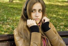 Free Young Woman With Headphones In The Park Royalty Free Stock Image - 17880946