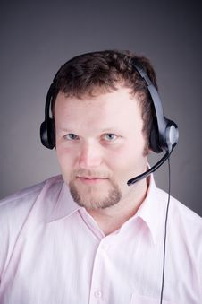 Free Smiling Male Customer Service Operator In Headset Royalty Free Stock Photos - 17883548