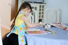 Free Adorable Little Girl With Long Dark Hair Draws Stock Photography - 17884972