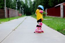 Adorable Little Girl On Roller Skates Royalty Free Stock Image