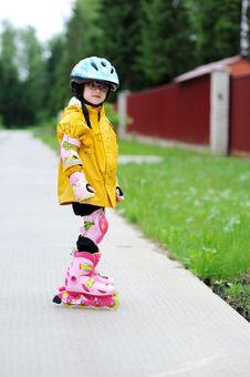 Adorable Little Girl On Roller Skates Stock Photos