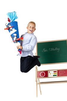 Boy On First School Is Happy And Jumps In The Air. Royalty Free Stock Images
