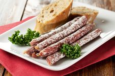 Free Small Salamis On A Plate Stock Image - 17886121